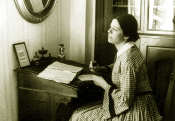 Жінка за письмовим столом. Фото, поч. ХХ ст.